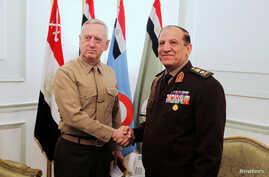 FILE - Egypt's Chief of Staff of the Armed Forces Sami Anan, right, shakes hands with the U.S. Commander of the Central Command James Mattis during a meeting in Cairo, Egypt, March 29, 2011. Anan announced his candidacy for president of Egypt on Satu...
