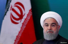 FILE - Iranian President Hassan Rouhani attends a meeting with Muslim leaders and scholars in Hyderabad, India, Feb. 15, 2018.