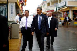 U.S. President Barack Obama and New Jersey Governor Chris Christie (L) walk on the boardwalk at Point Pleasant in New Jersey, May 28, 2013.