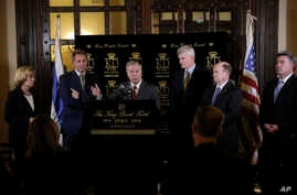 U.S. Senator Lindsey Graham, center, speaks as senators from left Maggie Hassan, Jeff Flake, Bill Cassidy, Chris Coons and Cory Gardner stand during a press conference in Jerusalem, Feb. 22, 2018.