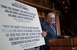 Senate Minority Leader Chuck Schumer, D-N.Y., holds a news conference to talk about the Democratic victory in the Alabama special election and to discuss the Republican tax bill in Washington, Dec. 13, 2017.