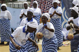 Members of the Women In Peacebuilding Network ( WIPNET) dance, sing and pray on May 8, 2015 in Monrovia.