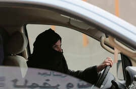 FILE - Aziza Yousef drives a car on a highway in Riyadh, Saudi Arabia, as part of a campaign to defy Saudi Arabia's ban on women driving, March 29, 2014.