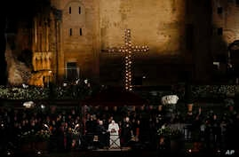 Pope Francis recites his prayer at the end of the Via Crucis (Way of the Cross) torchlight procession in front of the Colosseum on Good Friday, a Christian holiday commemorating the crucifixion of Jesus Christ and his death in Rome, Italy, March 30,
