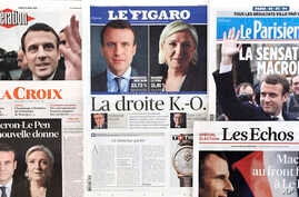 French newspaper front pages report the winners of the first round of the French presidential election, centrist candidate Emmanuel Macron and far-right candidate Marine Le Pen, April 24, 2017.