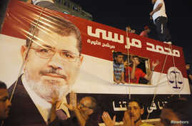 A picture of Egypt's President Mohamed Morsi is seen on a vehicle as his supporters gather at Tahrir square, Cairo, Egypt, July 10, 2012.