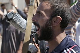 A Libyan rebel fighter in Zawiya, western Libya, reacts to the news that the city of Surman, an important strategic point, is now under the control of the rebel forces, August 14, 2011