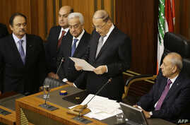 Newly elected Lebanese President Michel Aoun (C) gives a speech next to the Parliament Speaker Nabih Berri (R) as he takes an oath after he was elected at the Lebanese parliament in downtown Beirut, Oct. 31, 2016.