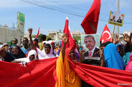 FILE - Somali people carry Turkish and Somali flags as they gather in support of Turkish President Recep Tayyip Erdogan and his government in Somalia's capital Mogadishu, July 16, 2016.