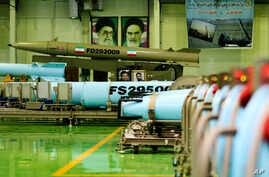 A photo released March 5, 2014 by the Iranian Defense Ministry purports to show missiles Fateh-110 (top) and Persian Gulf (bottom) in Iran.
