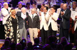 (From left) Jessye Norman, John Williams, Steven Spielberg, Yo-Yo Ma, Keith Lockhart and James Taylor celebrate the composer's 80th birthday onstage at Tanglewood, the summer home of the Boston Symphony Orchestra in western Massachusetts. (Hilary Sco