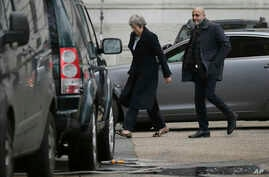 British Prime Minister Theresa May arrives at 10 Downing Street in London, Dec. 10, 2018.