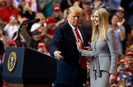 FILE - President Donald Trump greets his daughter Ivanka Trump as she arrives to speak during a rally in Cleveland, Nov. 5, 2018. The Chinese government granted 18 trademarks to companies linked to President Trump and his daughter Ivanka over the las...