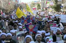 This frame grab from video provided by Iran Press, a pro-government news agency based in Beirut, shows pro-government demonstrators marching in Qom, Iran, Jan. 3, 2018. Iranian state TV channels aired footage of pro-government demonstrations in citie