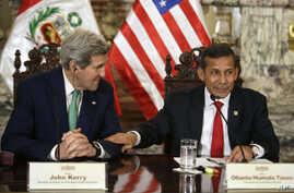 Peru's President Ollanta Humala, right, jokes with U.S. Secretary of State John Kerry — in Lima for a conference on climate change — as they talk to reporters following a private meeting in the Peruvian capital, Dec. 11, 2014.