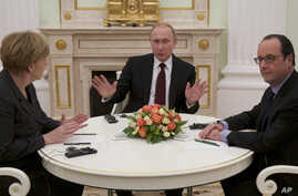Russian President Vladimir Putin, center, gestures during his talks with German Chancellor Angela Merkel, left, and French President Francois Hollande, right, in Moscow, Feb. 6, 2015.