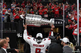 Washington Capitals left wing Alex Ovechkin (8) leaves the ice with the Stanley Cup after defeating the Vegas Golden Knights in Game Five of the 2018 Stanley Cup Finals at T-Mobile Arena.