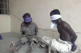 Suspected members of the radical Islamist sect Boko Haram are detained by the military in Bukavu Barracks in Kano state, Nigeria, March 21, 2012.
