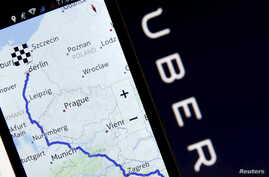 FILE - Nokia Maps is seen on a smartphone in front of a displayed logo of Uber in Zenica, Bosnia and Herzegovina, in this May 8, 2015 photo illustration.