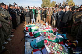 Mourners pray during a funeral of victims who were killed in a bomb attack at the offices of the Democratic Party of Iranian Kurdistan (PDKI) in Koy Sanjak, east of Erbil, Iraq, Dec. 21, 2016.