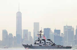 FILE - Sailors line the bow of the destroyer USS McFaul as it glides past One World Trade Center and the lower Manhattan skyline, in New York Harbor, May 2014.
