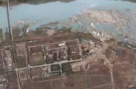 FILE - satellite image provided by GeoEye shows the area around the Yongbyon nuclear facility in Yongbyon, North Korea. The U.S.-Korea Institute at Johns Hopkins School of Advanced International Studies said shows that North Korea has resumed buildin