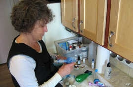 FILE - A photo provided by Laura Mentch, shows Laura Mentch of Bozeman, Mont., with her daily treatments for cystic fibrosis.