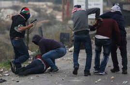 Undercover Israeli police arrest Palestinian demonstrators during clashes following protests against U.S. President Donald Trump's decision to recognize Jerusalem as the capital of Israel, in the West Bank city of Ramallah, Dec. 13, 2017.