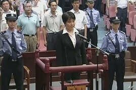 China Death Sentence: FILE - Gu Kailai, center in front, the wife of disgraced politician Bo Xilai, listens to the verdict during her trial at Hefei Intermediate People's Court in the eastern Chinese city of Hefei Monday, Aug. 20, 2012. Gu received a