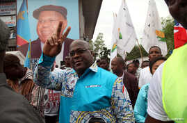 FILE - Felix Tshisekedi, leader of the Democratic Republic of Congo's opposition alliance known as the Rassemblement de l'opposition Congolaise, gestures to his supporters in the Limete Municipality of the DRC's capital Kinshasa, April 24, 2017.