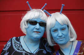 Science fiction enthusiasts Anne Clothier (L) and Gail Tomlinson, dressed as Andorians from Star Trek, pose for a photograph outside the 12th annual Sci-Fi London festival in east London, April 28, 2013.