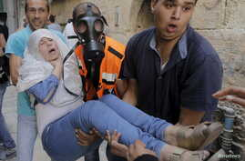 A Palestinian woman affected by tear gas is evacuated by medics during clashes between stone-throwing Palestinians and Israeli police on the compound known to Muslims as Noble Sanctuary and to Jews as Temple Mount in Jerusalem's Old City  September 1...