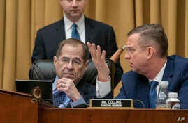 FILE - Judiciary Committee Chairman Jerrold Nadler, D-N.Y. (L), and Rep. Doug Collins, R-Georgia, the top Republican, confer during testimony by Acting Attorney General Matthew Whitaker on Capitol Hill, Feb. 8, 2019 in Washington.