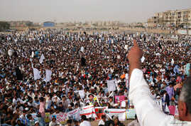 Members of Pakistan's Pashtun community, listen to their leader during a rally against, what they say, are human rights violations, organized by the Pashtun Tahaffuz Movement (PTM) in the southern city Karachi, Pakistan, May 13, 2018.