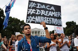 Carlos Esteban, 31, of Woodbridge, Va., a nursing student and recipient of Deferred Action for Childhood Arrivals, known as DACA, rallies with others in support of DACA outside of the White House, in Washington, Sept. 5, 2017.