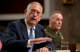 Defense Secretary Jim Mattis, left, accompanied by Joint Chiefs Chairman Gen. Joseph Dunford, speaks on Afghanistan before the Senate Armed Services Committee on Capitol Hill in Washington, Oct. 3, 2017.