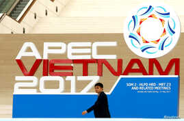 A delegate walks past decoration during the APEC Ministers Responsible For Trade