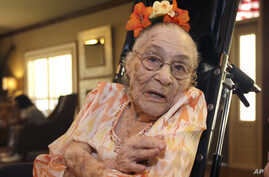 FILE - Gertrude Weaver poses at Silver Oaks Health and Rehabilitation Center in Camden, Ark., a day before her 116th birthday, July 3, 2014.