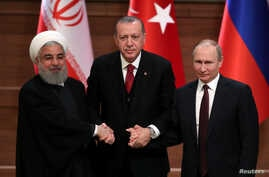 Presidents Hassan Rouhani of Iran, Recep Tayyip Erdogan of Turkey and Vladimir Putin of Russia hold a joint news conference after their meeting in Ankara, Turkey, April 4, 2018.