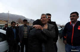Relatives of passengers who were believed to have been killed in a plane crash react near the town of Semirom, Iran, Feb. 18, 2018. (REUTERS/Tasnim News Agency)