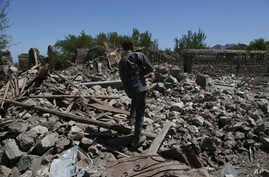 An Afghan security police walks at the destroyed house after an operation in Asad Khil near the site of a U.S. bombing in the Achin district of Jalalabad, east of Kabul, Afghanistan, Saturday, April 17, 2017.