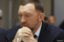 FILE - Oleg Deripaska attends an agreement signing ceremony with the Krasnoyarsk region's government in Moscow, Russia, Dec. 12, 2017.