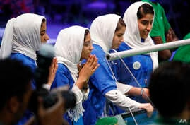 From left, Rodaba Noori, Somayeh Faruqi, Kawsar Rashan and Lida Azizi of Team Afghanistan encourage their robot during their final round of competition, at the FIRST Global Robotics Challenge, July 18, 2017, in Washington.