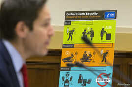 FILE - U.S. Centers for Disease Control and Prevention (CDC) Director Tom Frieden displays CDC educational materials as he testifies about the Ebola crisis in West Africa during a hearing of a House Foreign Affairs subcommittee on Capitol Hill in Was