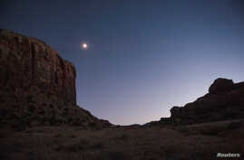 The moon glows over Indian Creek in the northern portion of Bears Ears National Monument, Utah, Oct. 29, 2017.