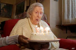 Emma Morano, 117 years old, celebrates her birthday in Verbania, Italy, Nov. 29, 2016.  At 117 years of age, Emma is now the oldest person in the world. For Americans, life expectancy has fallen to not quite 79 years.