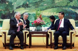 U.S. Secretary of State Rex Tillerson, left, meets with China's President Xi Jinping at the Great Hall of the People, Saturday, Sept. 30, 2017, in Beijing.