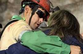 Chilean Rescuers Begin Pulling Out Trapped Miners