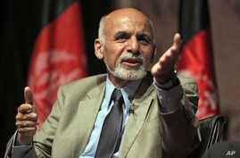 In this picture taken on Wednesday, June 11, 2014, Afghanistan's presidential candidate Ashraf Ghani Ahmadzai speaks during his last campaign rally in Kabul, Afghanistan. With fears of violence high, Afghanistan braced for a final election to choose