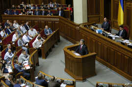 FILE - Ukrainian President Petro Poroshenko is seen speaking to lawmakers in the Parliament of Ukraine, in Kyiv, in a June 4, 2015, photo.